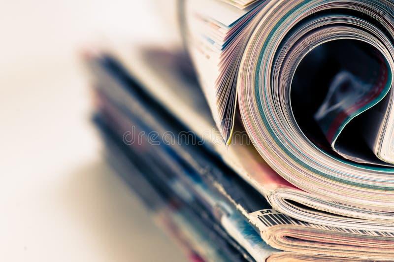tidskriftrulle arkivbild