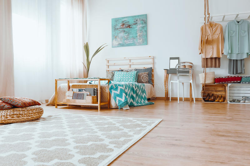 Tidy colorful bedroom royalty free stock photography