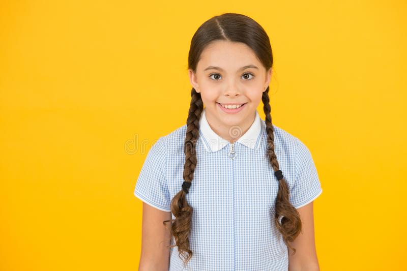 Tidy hairstyle. Little girl with cute braids. Beautiful braids. Braided hairstyle concept. Girl with braided hair style stock photography