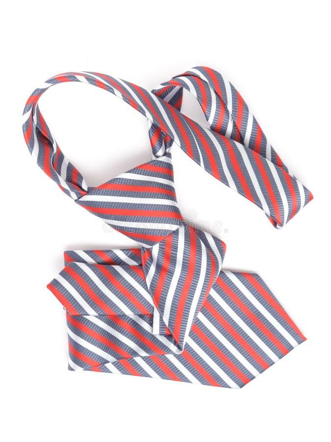 Tie. Elegant red tie isolated on white royalty free stock photo