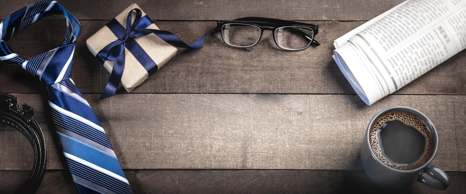 Tie, Belt, And Gift Box With Reading Glasses, Newspapers, And Coffee stock photography