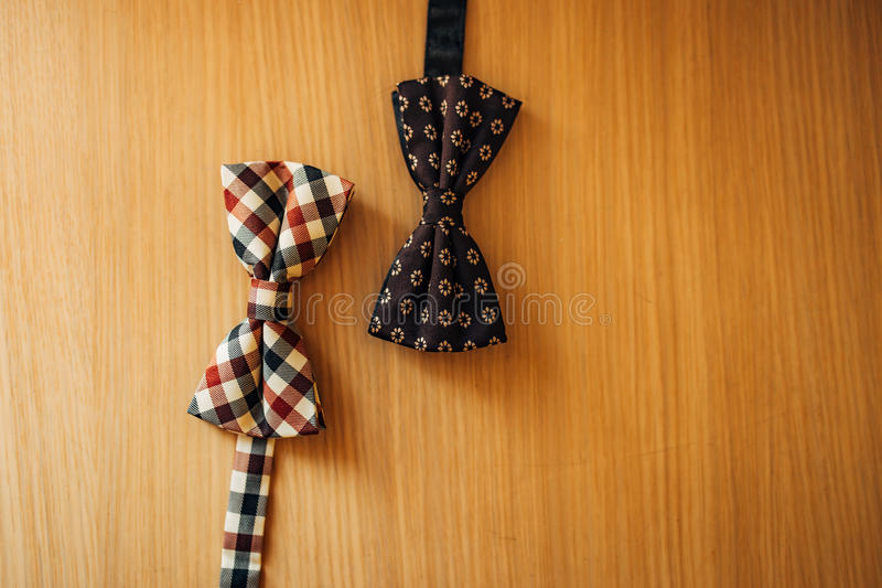 Tie Butterfly on a wooden background royalty free stock photo