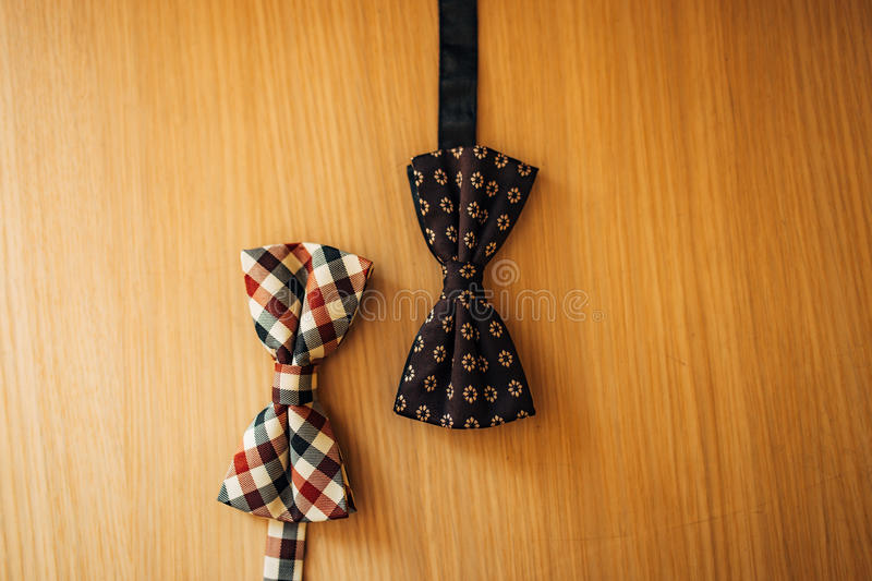 Tie Butterfly on a wooden background royalty free stock image