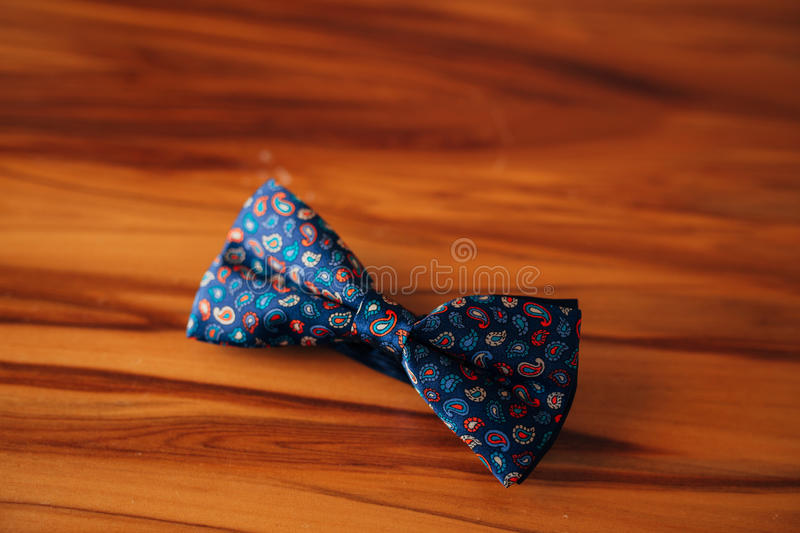 Tie Butterfly on a wooden table royalty free stock images