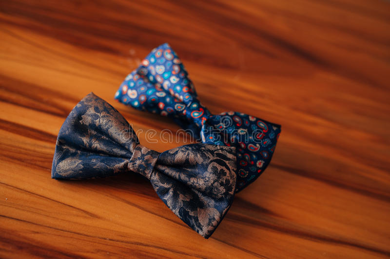 Tie Butterfly on a wooden table stock image