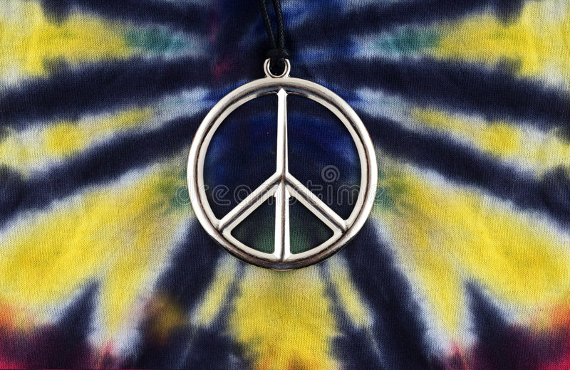 Tie dye shirt peace sign. Tie dye shirt with peace sign necklace stock photos