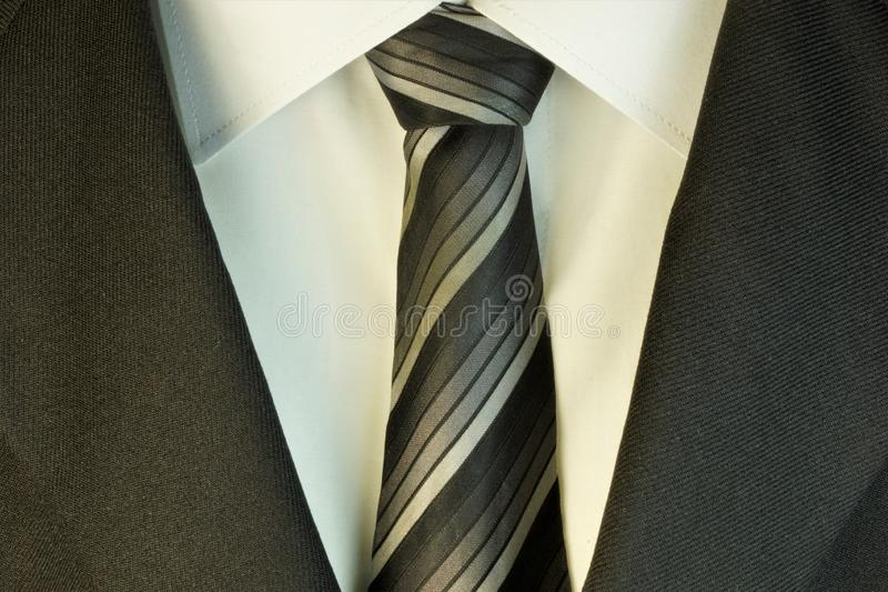 Tie, suit jacket and white shirt in the wardrobe of men decoration, accessory, business clothes, buy in the store. stock images