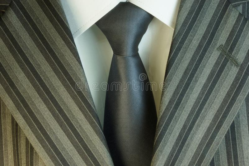 Tie, suit jacket and white shirt in the wardrobe of men decoration, accessory, business clothes, buy in the store. Clothes for wedding, graduation, business stock photo