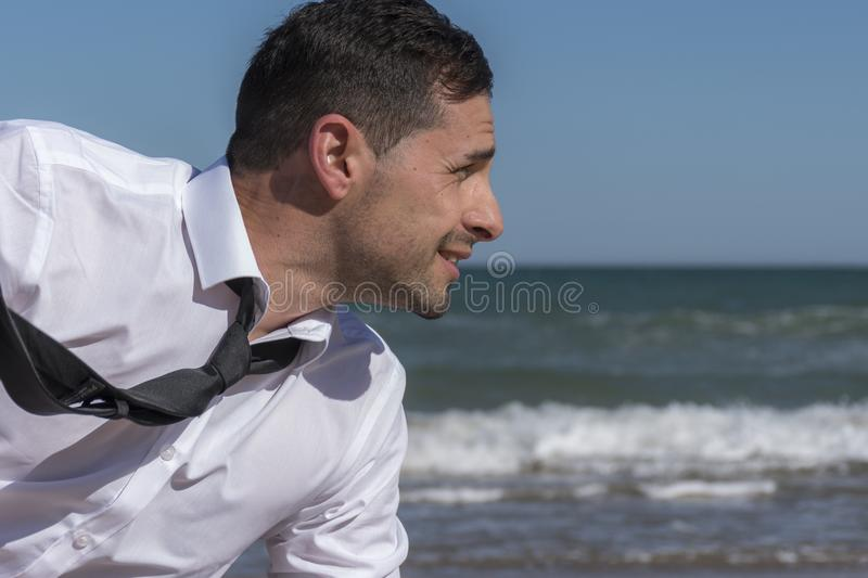 With the tie in the wind facing the problems stock photos