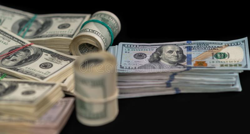 Tied bundles and rolls of USD banknotes royalty free stock images