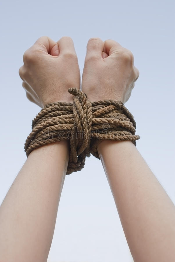 Tied with rope hands stock photography
