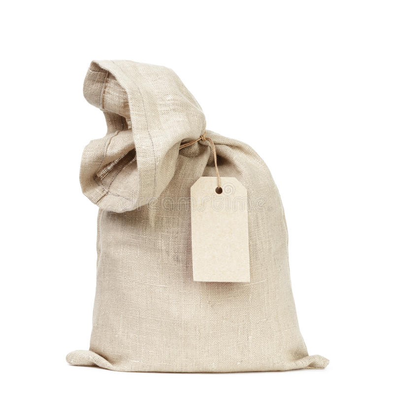 Tied sack bag with paper tag. Isolated on white royalty free stock photography