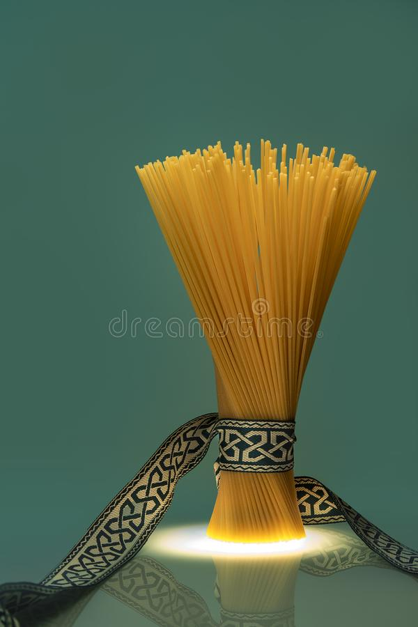 Tied spaghetti pack with ribbon with greek patterns royalty free stock photo