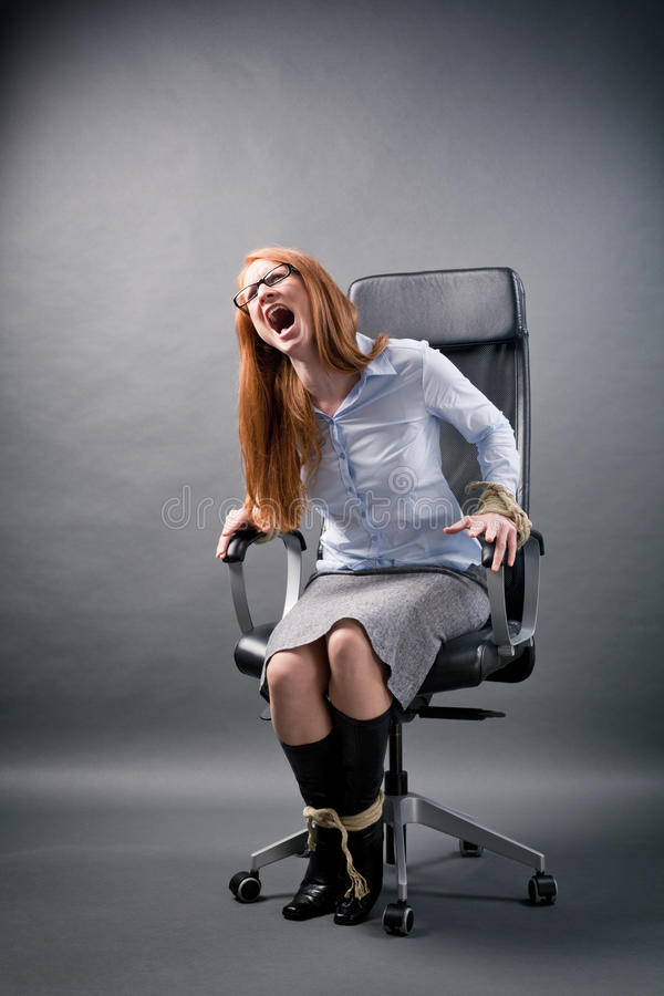 Tied Up Businesswoman Shouting for Help stock photography