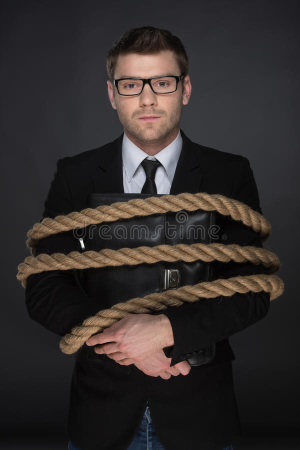 Tied up men. stock photo. Image of frustration, business