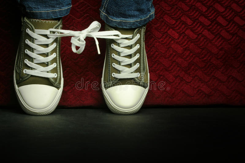Tied up shoes in the spotlight stock photography