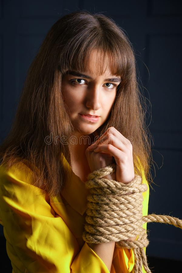 Free Tied With Rope Young Woman Tied Hands Woman In Captivity Stock Images - 145108264