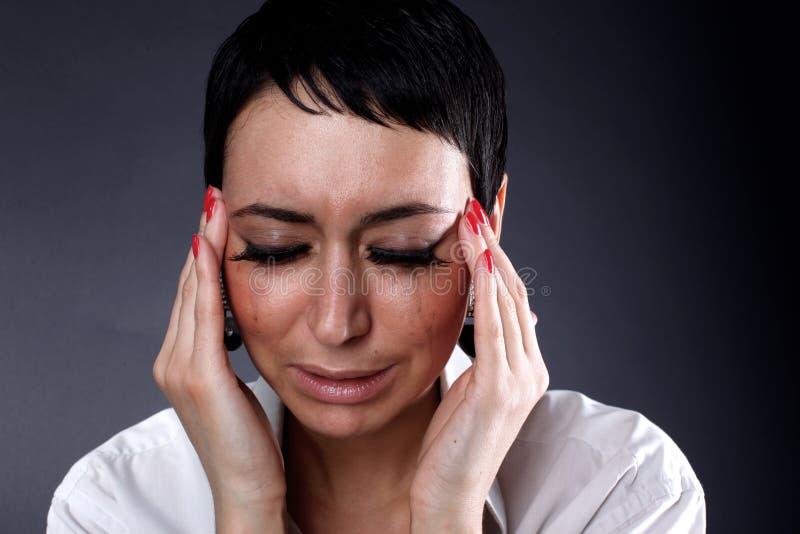 Tiefstand und Kopfschmerzen stockfotografie