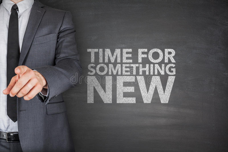 Tiem for something new on blackboard. Time for something new on blackboard with businessman royalty free stock image