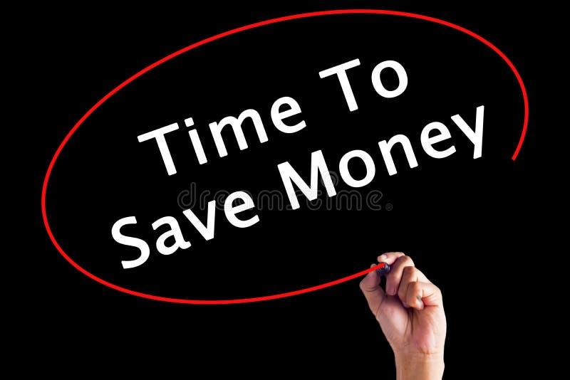 Tiempo de la escritura de la mano para ahorrar el dinero imagen de archivo libre de regalías