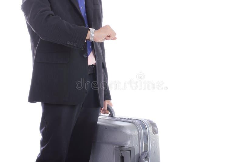 Tiempo del equipaje y del reloj del control del hombre de negocios fotografía de archivo libre de regalías
