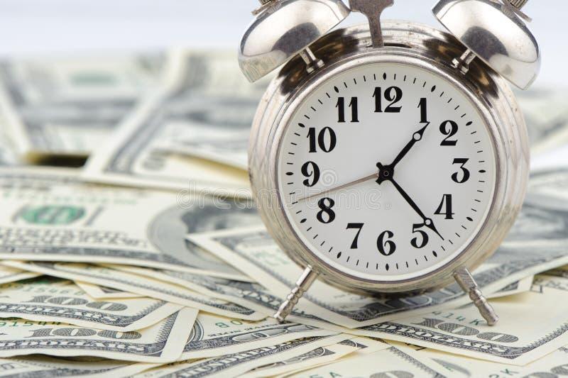 Tiempo - dinero. Concepto del asunto. imagen de archivo libre de regalías