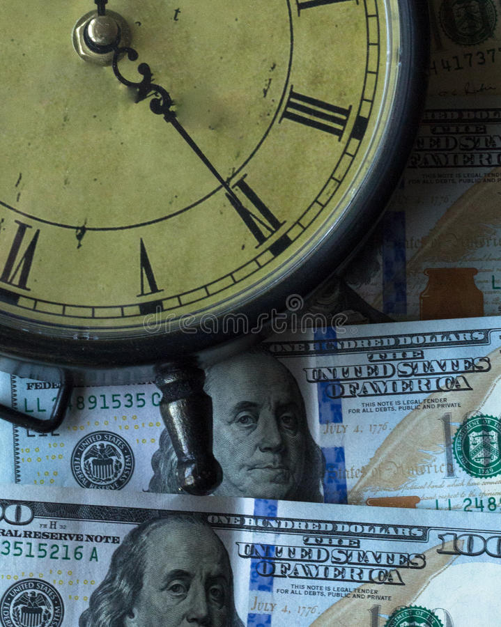 Tiempo - un dinero imagen de archivo