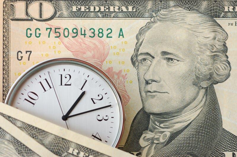 Tiempo y dinero fotos de archivo libres de regalías
