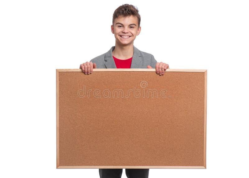Tien jongen met bordje stock foto's