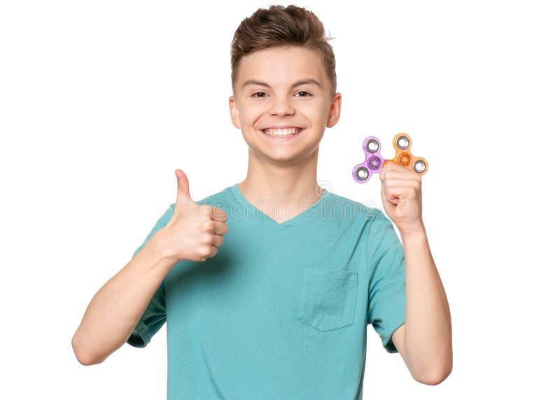 Tien jongen met spinner stock afbeeldingen