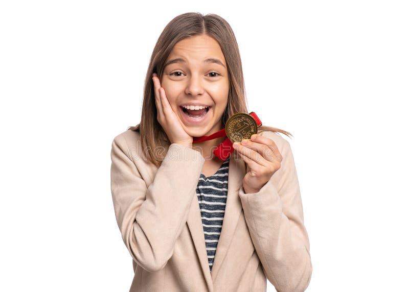 Tien meisje met medaille stock afbeelding