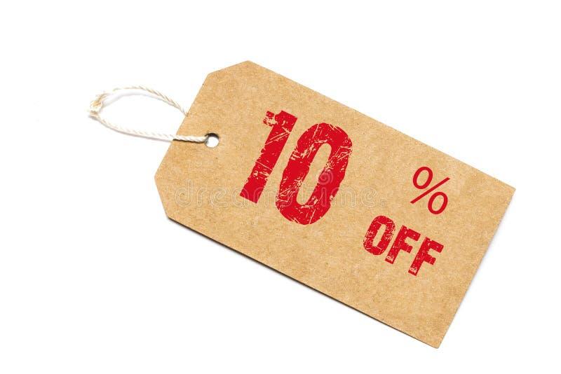 Tien percenten van korting - een document prijskaartje op witte backgroun stock afbeeldingen