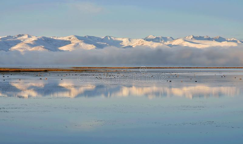 Tien Shan mountains near calm water of Son-Kul lake,natural landmark of Kyrgyzstan,Central Asia stock images