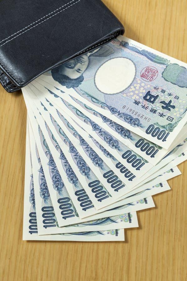 Tien stukken van duizend Japanner int portefeuille dichte omhooggaand stock foto