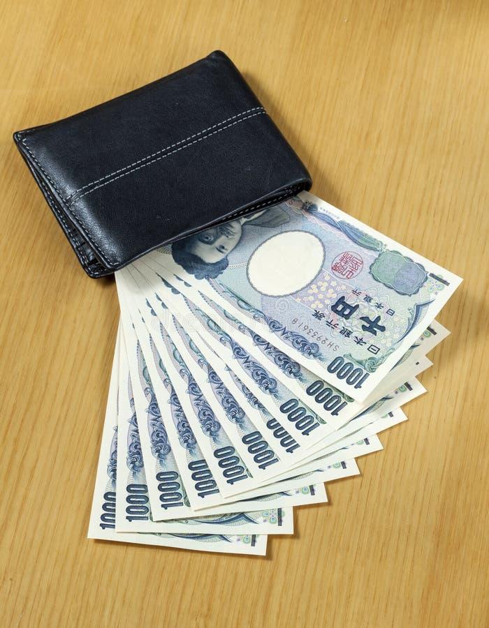 Tien stukken van duizend Japanner int portefeuille dichte omhooggaand stock afbeelding