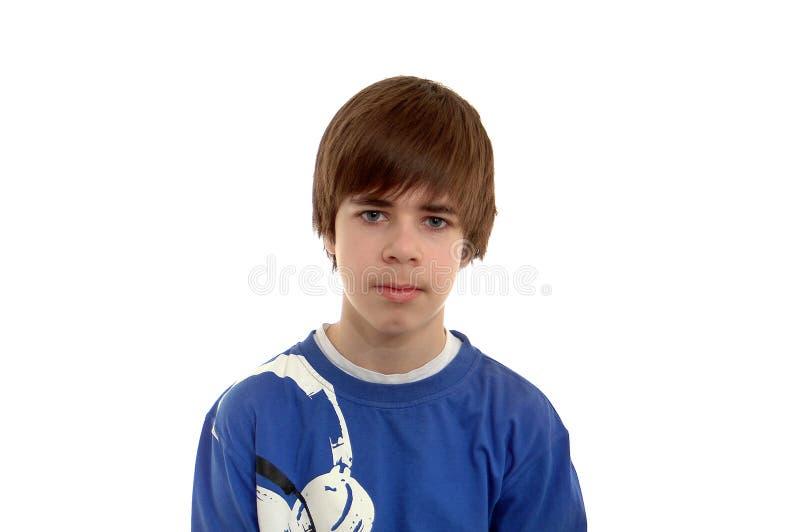 Tiener in blauw dat op wit wordt geïsoleerde royalty-vrije stock foto's