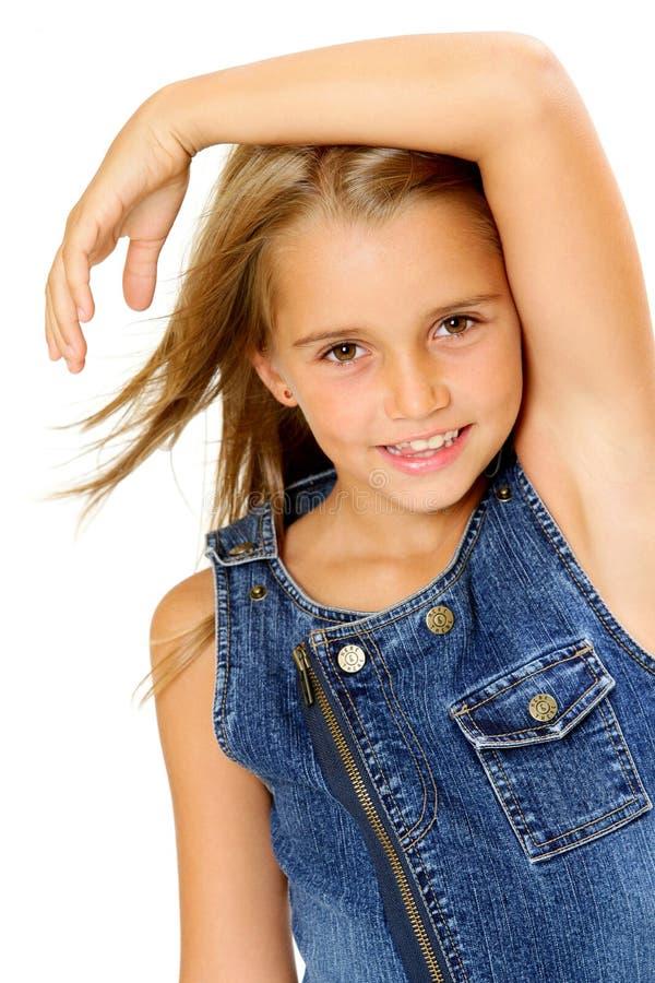 Tiener in denimkleding stock foto