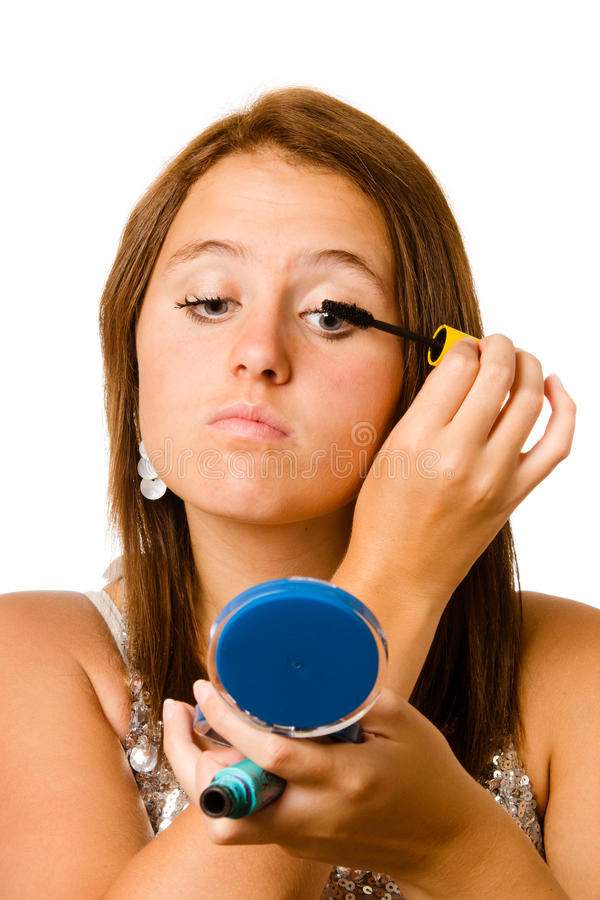 Tiener die make-up of schoonheidsmiddelen toepast stock foto's