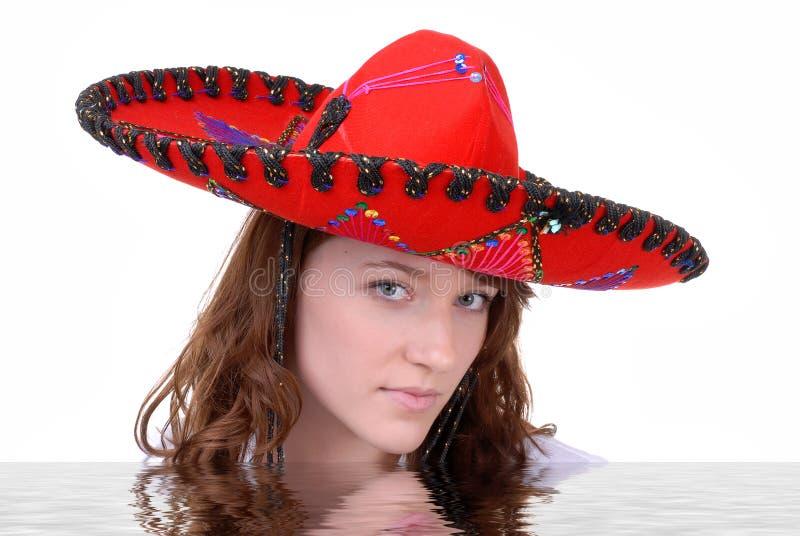 Tiener die Mexicaanse Sombrero draagt stock fotografie