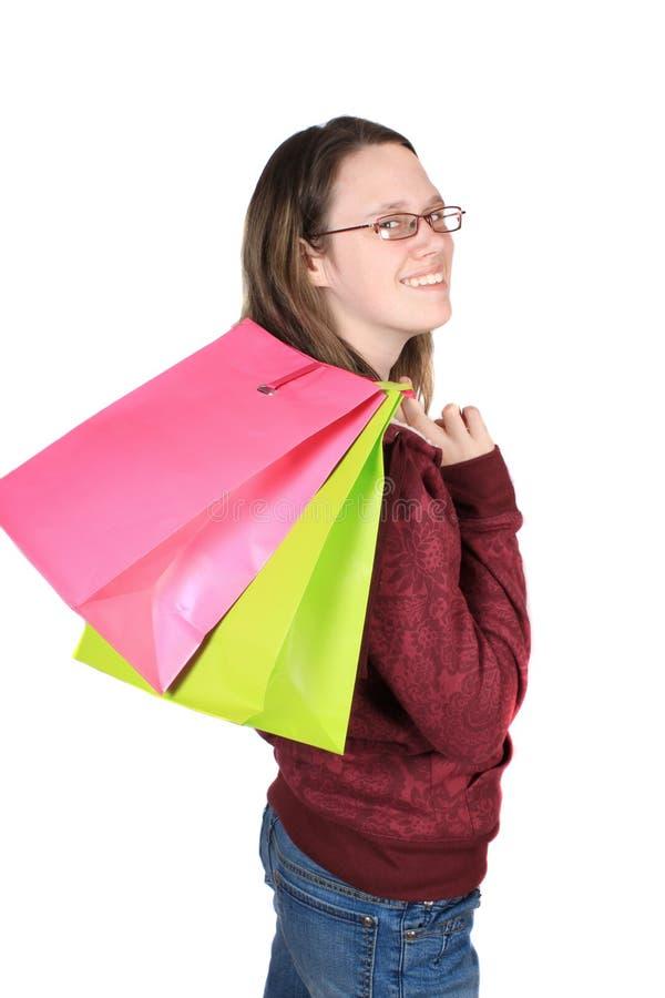 Tiener girll met het winkelen zakken stock afbeeldingen