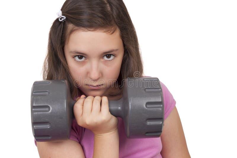 Tiener het opheffen gewicht stock afbeelding