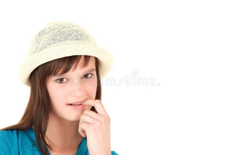 Tiener in hoed stock foto