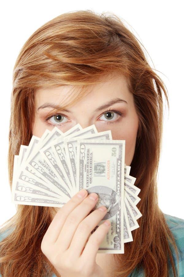 Tiener met dollars stock foto