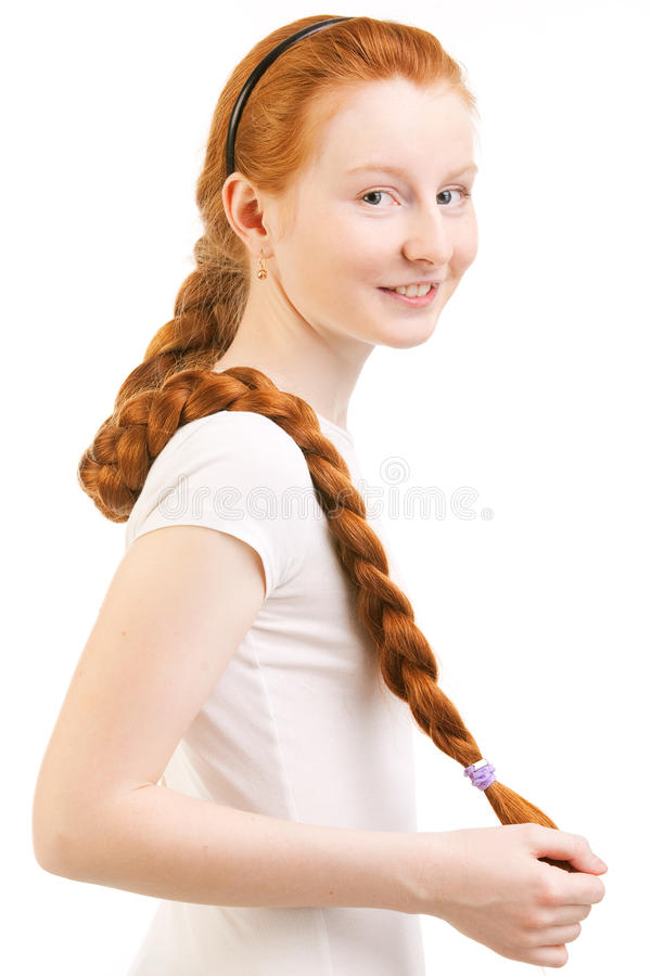 Tiener met lang rode vlecht stock afbeeldingen