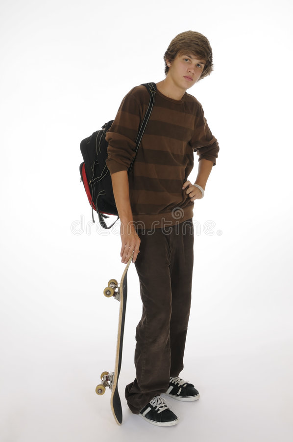 Tiener met rugzak en skateboard stock foto's