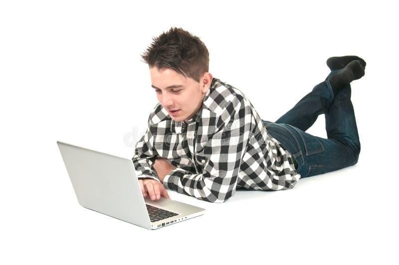 Tiener op laptop royalty-vrije stock fotografie
