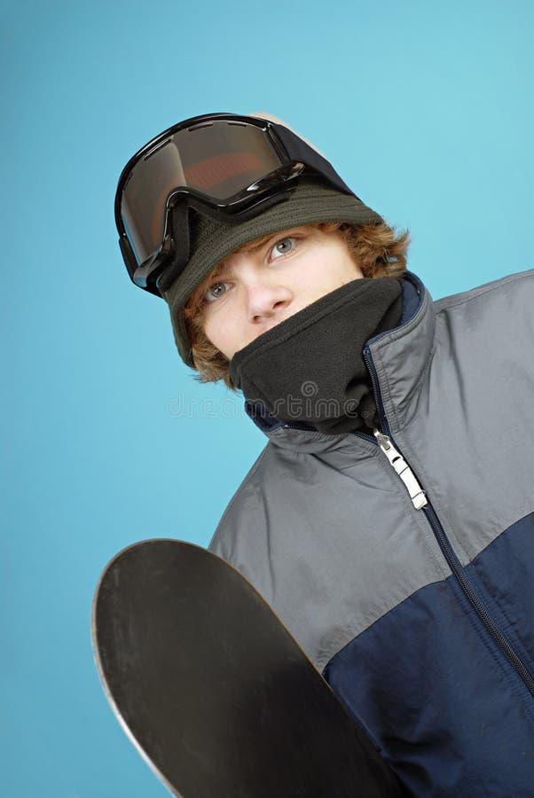 Tiener snowboarder stock foto's