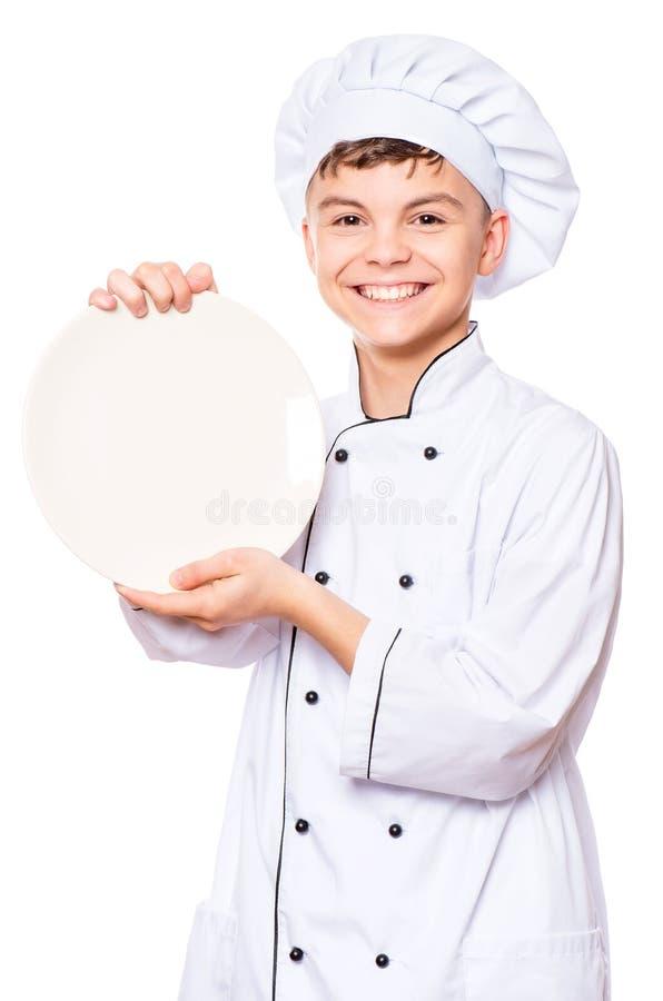 Tienerjongen die eenvormige chef-kok dragen royalty-vrije stock afbeeldingen