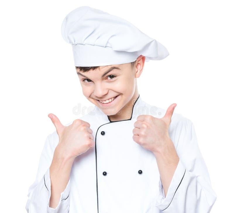Tienerjongen die eenvormige chef-kok dragen royalty-vrije stock fotografie