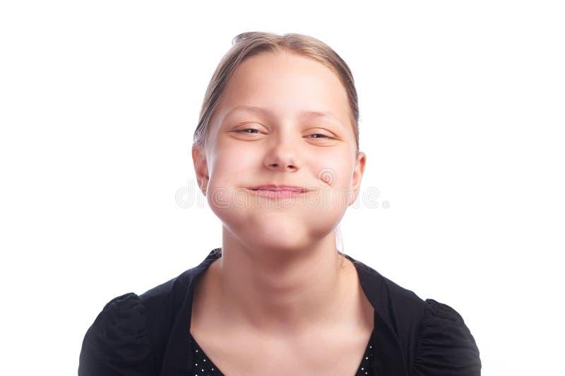 Tienermeisje die grappige gezichten op witte achtergrond maken royalty-vrije stock afbeelding